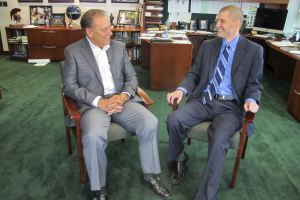 Adam Burns talks with Michigan State University basketball coach, Tom Izzo, after accepting his Excellence in Education award.