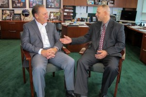 Brett Burns talks with Michigan State University basketball coach, Tom Izzo, after accepting his Excellence in Education award.