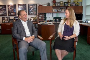Shirley Ries talks with Michigan State University basketball coach, Tom Izzo, after accepting his Excellence in Education award.