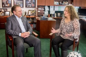 Nancy Kattoula talks with Michigan State University basketball coach, Tom Izzo, after accepting her Excellence in Education award.