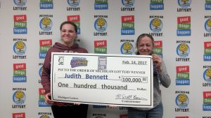 Judith Bennett (right) and her daughter, Jessica, pose for a photo after Judith collected a $100,000 Lottery prize.