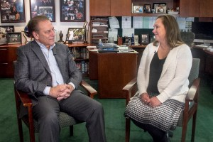 Melinda Eggleston talks with Michigan State University basketball coach, Tom Izzo, after accepting her Excellence in Education award.