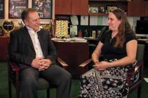 Nicole Ames-Powell talks with Michigan State University basketball coach, Tom Izzo, after accepting her Excellence in Education award.