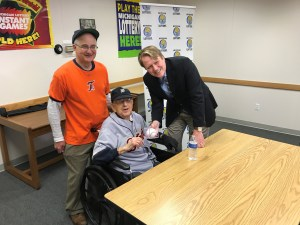Lottery Commissioner, Aric Nesbitt, poses for a photo with Home Run Riches winner Stanley Jastrzembski and his son Mark Jastrzembski.