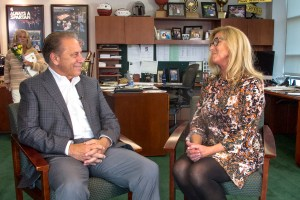 Dawn Hayes talks with Michigan State University basketball coach, Tom Izzo, after accepting her Excellence in Education award.