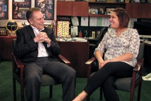 Michelle DuBois talks with Michigan State University basketball coach, Tom Izzo, after accepting her Excellence in Education award.