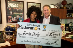 Sirrita Darby poses for a photo after accepting her Excellence in Education award from Michigan State University basketball coach Tom Izzo.