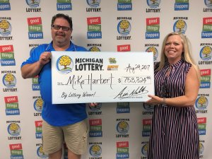 Mike Harbert and his wife, Sherrie, pose for a photo after collecting their $753,824 Fast Cash Jackpot Slots prize.