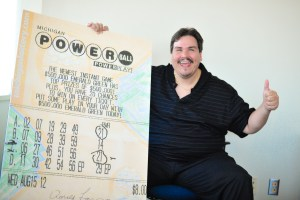 Donald Lawson smiles with an image of his winning ticket.
