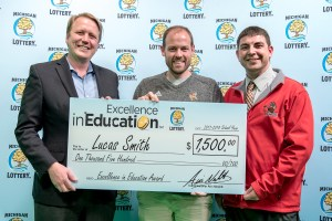Lucas Smith (center) poses for a photo with Michigan Lottery Commissioner, Aric Nesbitt, and Bangor Public Schools 5-12 Principal, Mike Dandron, after accepting his Excellence in Education Award.