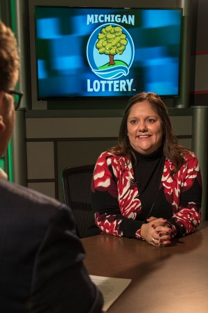 Kerri Moccio is interviewed after being presented with an Excellence in Education award from the Michigan Lottery.