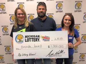 Brenda Jewell (left) poses for a photo with her husband, Brent, and daughter, Kayleigh, after collecting her $1 million prize.