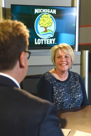 Julie Wright is interviewed after being presented with an Excellence in Education award from the Michigan Lottery.