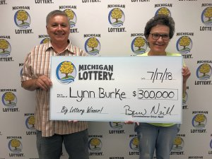 Lynn Burke and her husband, Robert, smile after claiming a $300,000 Double Bonus Cashword prize.