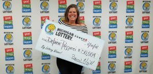 Delaine Passucci, smiles after collecting a $50,004 Powerball prize.