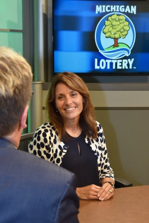 Kristen Schwartzenberger is interviewed after being presented with an Excellence in Education award from the Michigan Lottery.