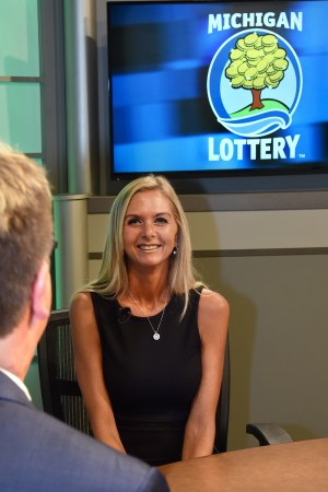 Shannon Wintz is interviewed after being presented with an Excellence in Education award from the Michigan Lottery.
