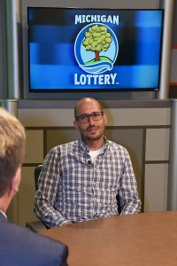 Carl Spina is interviewed after being presented with an Excellence in Education award from the Michigan Lottery.