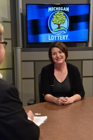 Tracey Jaworski is interviewed after being presented with an Excellence in Education award from the Michigan Lottery.