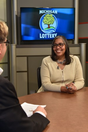 Sharon Taylor is interviewed after being presented with an Excellence in Education award from the Michigan Lottery.
