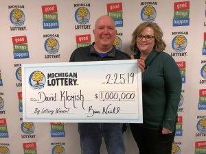David and Audra Klemish pose for a photo after winning a $1 million Mega Millions prize.