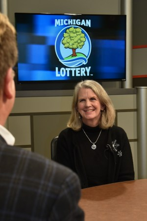 Kathleen Tighe is interviewed after being presented with an Excellence in Education award from the Michigan Lottery.