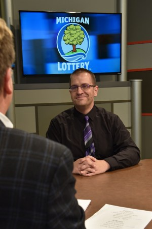 Ward Donovan is interviewed after being presented with an Excellence in Education award from the Michigan Lottery.