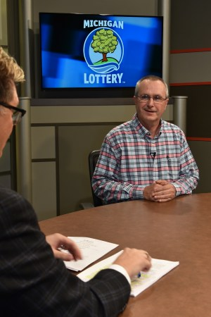 Stewart Kieliszewski is interviewed after being presented with an Excellence in Education award from the Michigan Lottery.
