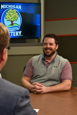 Matthew Fields is interviewed after being presented with an Excellence in Education award from the Michigan Lottery.