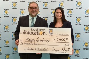 Meagen Granberry (right) poses for a photo with Michigan Lottery public relations director, Jeff Holyfield, after accepting her Excellence in Education Award.