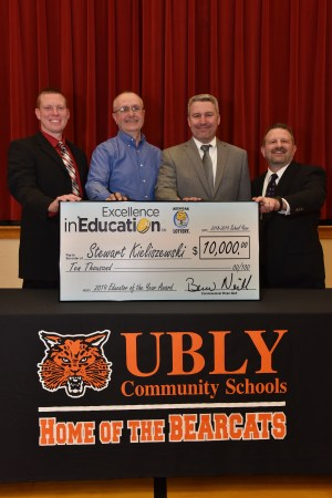 2019 Michigan Lottery Educator of the Year, Stewart Kieliszewski (second from left), poses for a photo with (left to right) Ubly Junior High School and Ubly High School Principal, Jeremy Weaver, Michigan Lottery Commissioner, Brian O. Neill, and Ubly Schools Superintendent, Joe Candela.