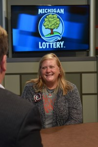Jessie Bassett is interviewed after being presented with an Excellence in Education award from the Michigan Lottery.