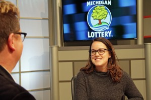 Erin Pintek is interviewed after being presented with an Excellence in Education award from the Michigan Lottery.