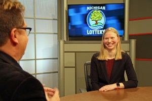 Megan Sidge is interviewed after being presented with an Excellence in Education award from the Michigan Lottery.