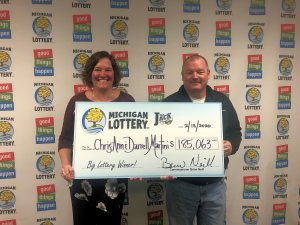Chris-Ann Martini and her husband, Darrell, smile after collecting a $185,063 Club Keno The Jack prize.