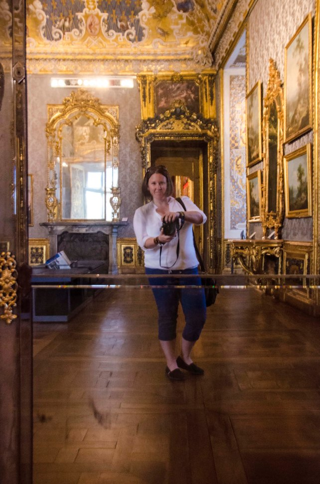 Amanda's reflection in a fancy museum mirror in Milan, Italy