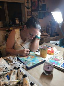 "Elizabeth creating ""Spring Bird"" in home studio"