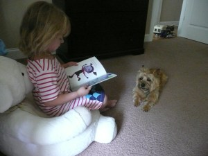 Lisa's daughter reading to doggy