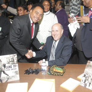 State Senator Spencer Coggs is congratulated by Governor Jim Doyle for his work on getting the Juneteenth Day legislation passed. (Photo by Robert A. Bell)
