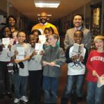 Nearly 100 Milwaukee third graders receive donated dictionaries to help further education