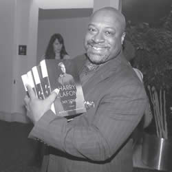 Dr. Robert (Bert) Davis, president & CEO of the Zoological Society of Milwaukee was one of the attendees for the YWCA's annual event, 'Promoting Racial Justice'. He was so inspired by Belafonte's address that he made sure he purchased several of his books. (Photo by Robert A. Bell)
