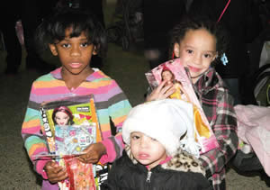 There were gifts and toys for each gender and various age groups the smiles on these girls faces tell the joy shared that day. (Photo by Cy White)