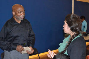 SDC Commissioner Dr. Gary Williams discusses youth and poverty with Rebecca Arcos following a public forum at Journey House