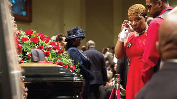 Lesley McSpadden (C) arrives at Friendly Temple Missionary Baptist Church for the funeral of her son Michael Brown on August 25, 2014 in St. Louis, Missouri. Michael Brown, an 18-year-old unarmed teenager, was shot and killed by Ferguson Police Officer Darren Wilson in the nearby town of Ferguson, Missouri on August 9. Photo Source: Scott Olson/Getty Images North America