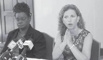 Congresswoman Gwen Moore and Democratic National Committee (DNC) chief, Debbie Wasserman Schultz (photo by Robert Bell)