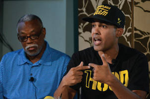 Hip hop artist and activist Jasiri X (right) speaks during a town hall discussion on Michael Brown's death in Ferguson, Mo., and police brutality as Ron Hampton, former executive director of the National Black Police Association looks on. (Freddie Allen/NNPA)