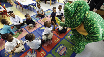 Ready Freddy visits prekindergarten students at a public school in Buffalo, N.Y. (David Duprey/AP Photo)