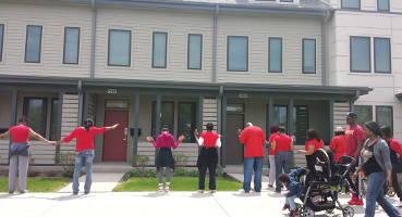 Participants pray over a section of the Westlawn housing project on the 6200 block.
