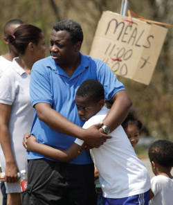 salvation-army-providing-emergency-disaster-relief-meals-father-son-embrace