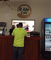 Visitors stop for lunch at the Running Rebels restaurant, the R-Life Cafe.